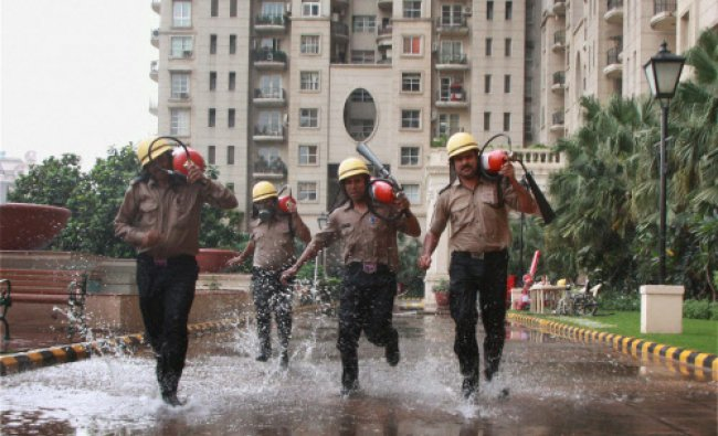 Fire and Rescue Services personnel during a mock drill in Gurgaon...