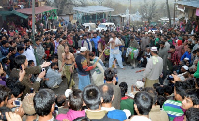 Kashmiri Muslims watching a traditional folk play during the annual Aishmuqam festival...