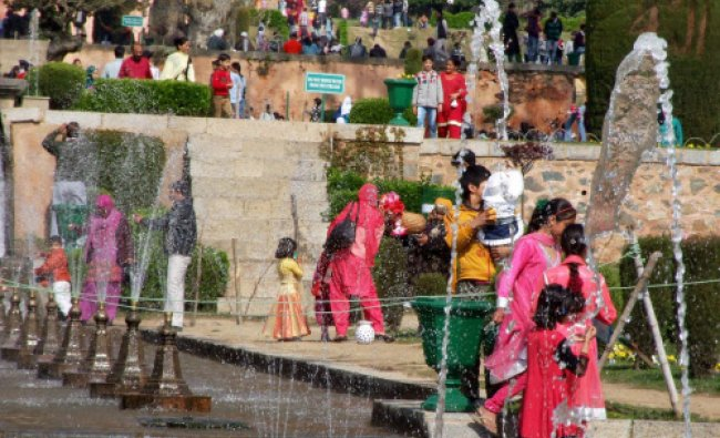 Locals and tourists enjoy at Mughal Garden on the occasion of Baisakhi Festival in Srinagar...