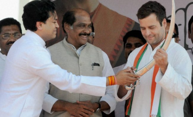 Congress Vice-President Rahul Gandhi being present a sword by Amit Deshmukh as Maharashtra...