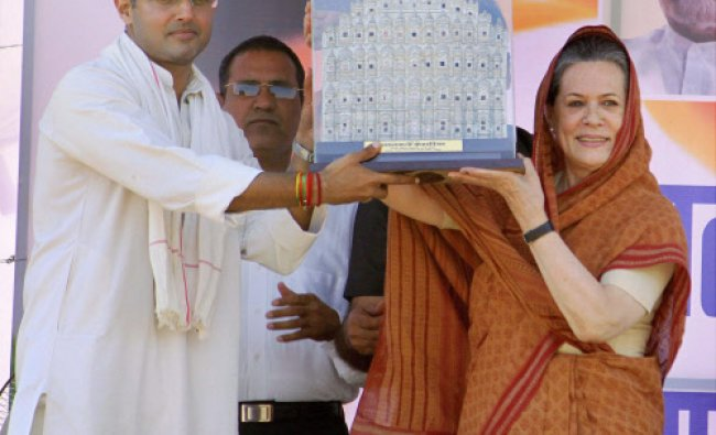 UPA Chairperson Sonia Gandhi being presented a memento by Congress candidate from Ajmer...