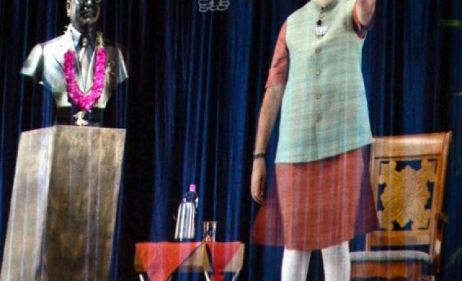 BJP prime ministerial candidate Narendra Modi addressing supporters through 3d video...