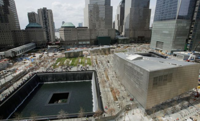 The September 11 Museum entrance pavilion, right, sits next to one of the September 11 Memorial...