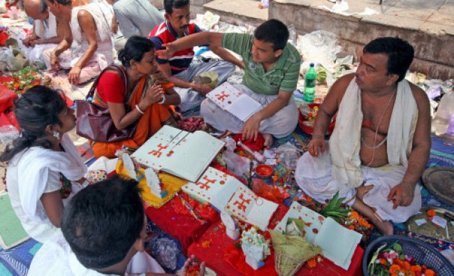 A business family offering puja at Kalighat Temple on Bengali New Year day, Kolkata...