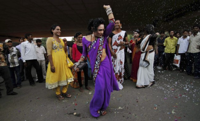 An eunuch dances to celebrate the Supreme Courts verdict recognizing a third gender category...