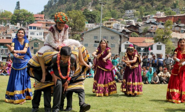 Girl students perform Giddha on the occasion of Himachal Day in Chamba...