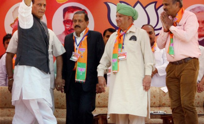 BJP President Rajnath Singh waves to the crowd during an election campaign rally in Udhampur...