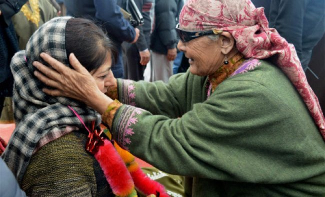 Peoples Democratic Party (PDP) President Mehbooba Mufti with a supporter at an election road...