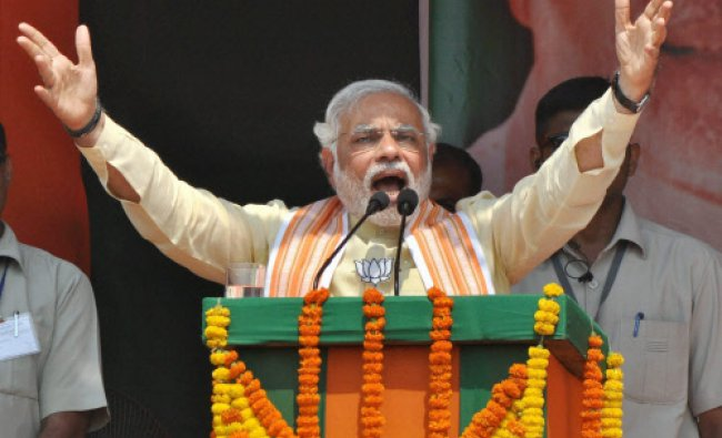 BJP\'s PM candidate Narendra Modi addresses an election campaign rally in Dhanbad...
