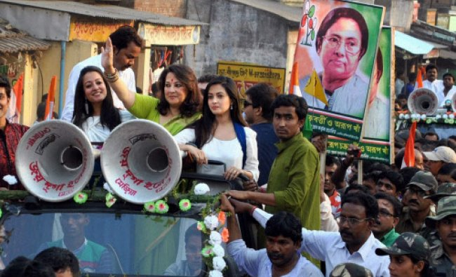 TMC candidate Moonmoon Sen with her daughters during her election campaign in Bankura...
