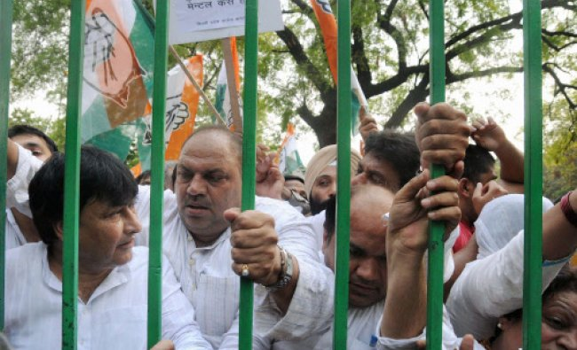 Delhi Pradesh Congress Committee (DPCC) workers holding a protest demonstration against...