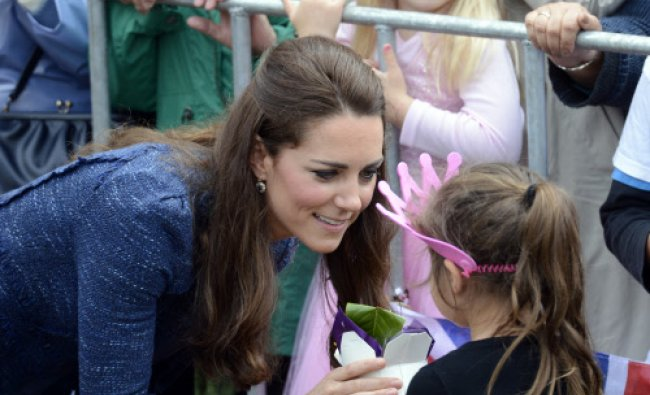 Britain\'s Kate, the Duchess of Cambridge meets with a girl during a walkabout in the Civic Square...