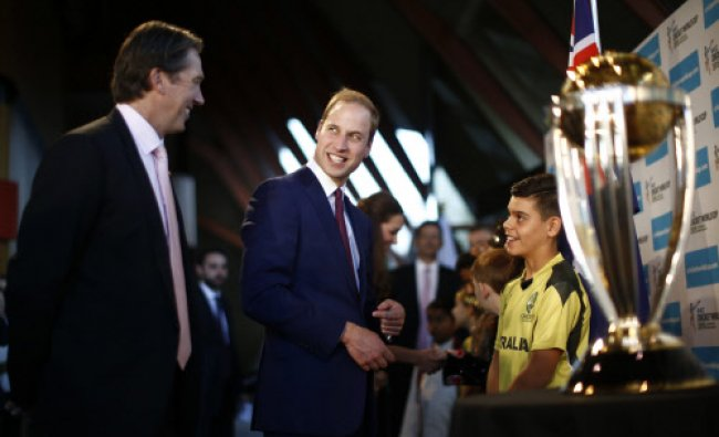 Britain\'s Prince William looks at former Australian cricketer Glenn McGrath as he is flanked...