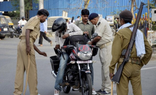 Policemen conduct checking on the eve of Lok Sabha elections in Patna...