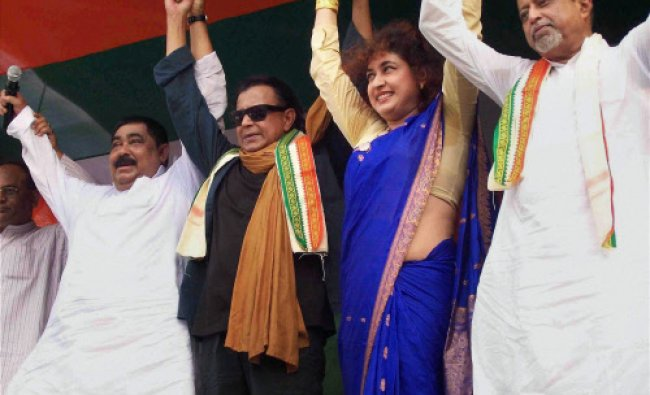 Bollywood actor and TMC MP Mithun Chakrabortry (2nd L) with TMC general secretary Mukul...