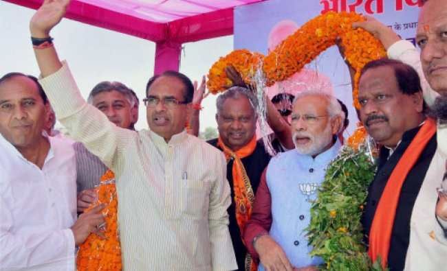 BJP\'s PM candidate Narendra Modi with MP CM Shivraj Singh Chouhan at an election meeting...
