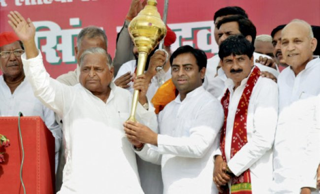 Samajwadi Party chief Mulayam Singh Yadav holds a mace during an election campaign meeting...