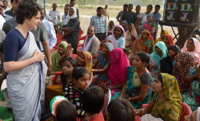 Priyanka Vadra addresses village women during her election campaign for her mother...