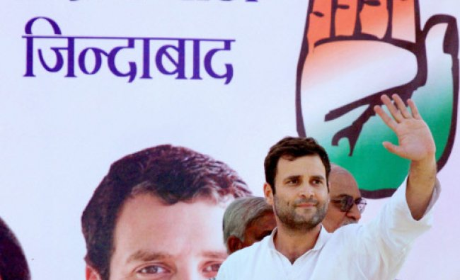 Congress Vice President Rahul Gandhi waves at an election rally in Unnao...