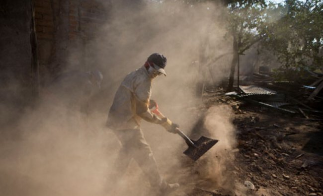 A city worker helps clear away debris caused by recent earthquakes in Nagarote, Nicaragua...