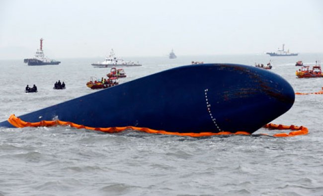 Rescue boats sail around the South Korean passenger ship \'Sewol\' which sank, during their rescue...
