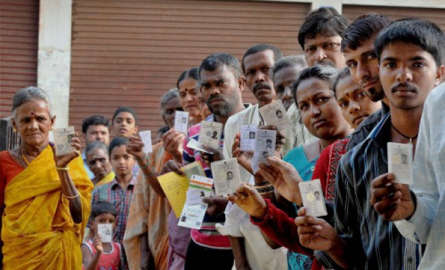 Voters wait in a queue to cast votes for the Lok Sabha elections in Chikmagalur on Thursday. PTI...