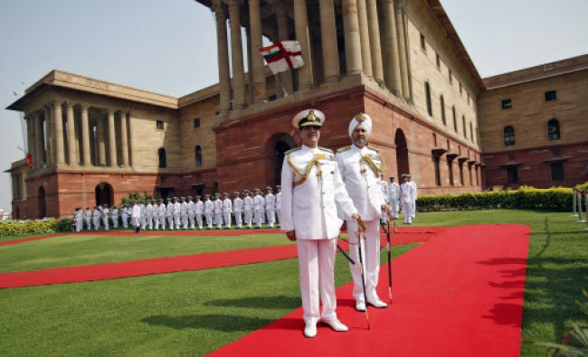 Newly appointed Chief of Naval Staff Admiral R. K. Dhowan (C) poses for a picture after inspecting..
