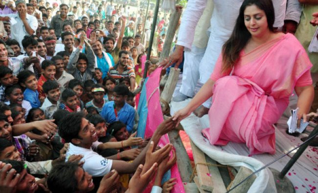 Congress leader Nagma meets students during an election campaign in favour of party...