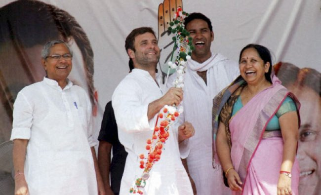Congress Vice President Rahul Gandhi is presented a bow and arrow a memento at an election...
