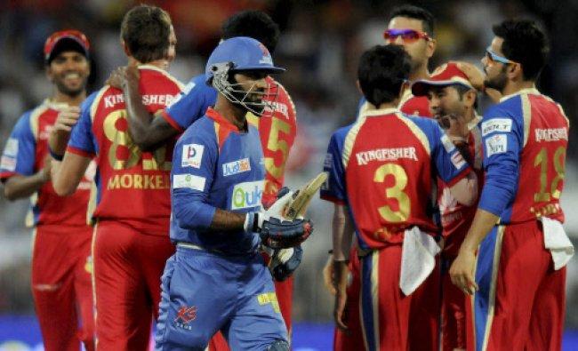 Dinesh Karthik of the Delhi Daredevils walks back after getting out during match 2...