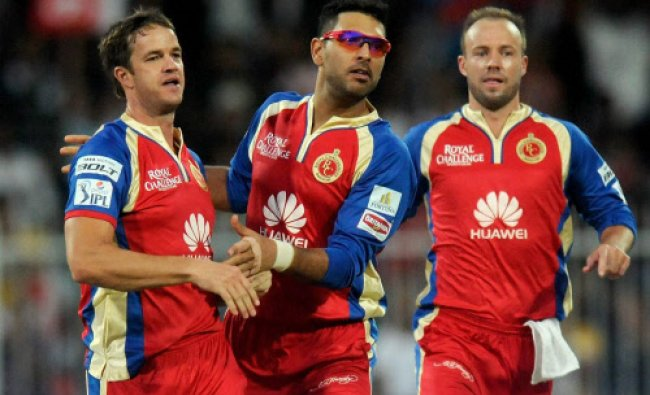 Albie Morkel of the Royal Challengers Bangalore celebrates the wicket of Dinesh Karthik...