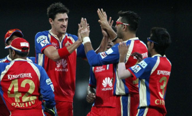 Mitchell Starc of the Royal Challengers Bangalore celebrates the wicket of Mayank Agarwal...