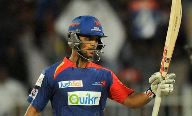 Jean-Paul Duminy of the Delhi Daredevils acknowledges teammates after scoring a half century...