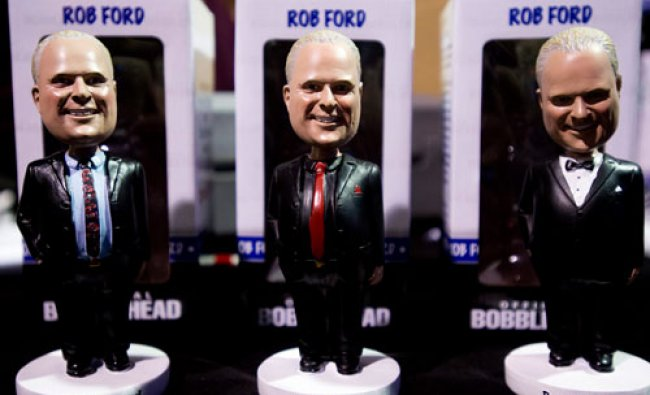 Toronto Mayor Rob Ford bobble heads are on display for sale as Ford launches his re-election...