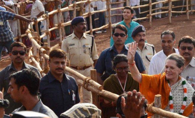 Congress President Sonia Gandhi waves at an election meeting in Neemuch, Madhya Pradesh...