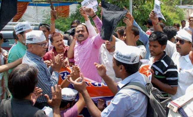 BJP supporters clash with AAP supporters during AAP leader Prashant Bhushan\'s press conference...