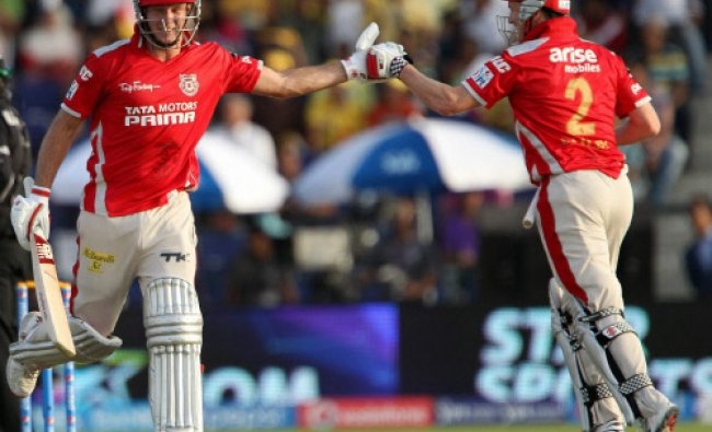 George Bailey of the Kings X1 Punjab celebrates the win with David Miller during an IPL 7...