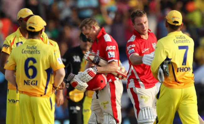 David Miller shakes hands with MS Dhoni captain of The Chennai Superkings after an IPL 7 match in...