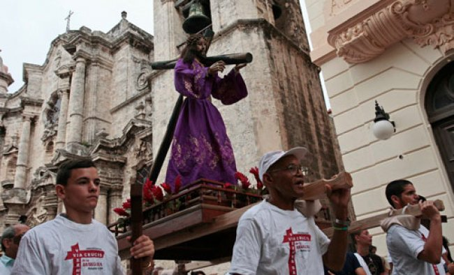 Roman Catholics carry a statue of Jesus Christ through the streets of Old Havana, during the...