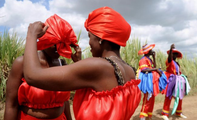 Women adjust their outfits as they prepare to take part in a ritual dance during a Gaga ceremony...