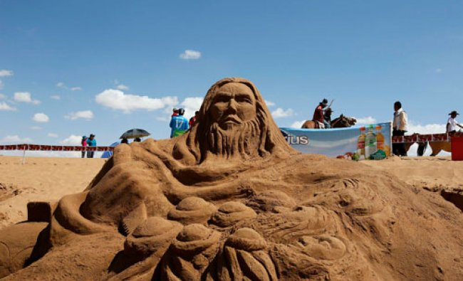 A sand sculpture of Simon Zelotes preaching the gospel is seen during Holy Week celebrations in...