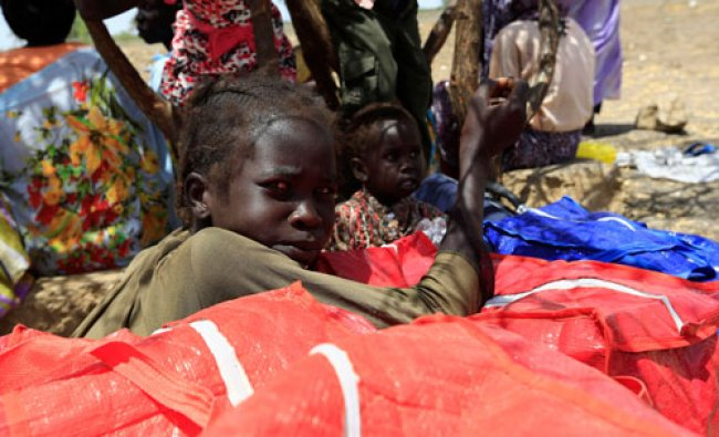 South Sudanese fleeing an attack on the South Sudanese town of Rank, rest during arrival at a...