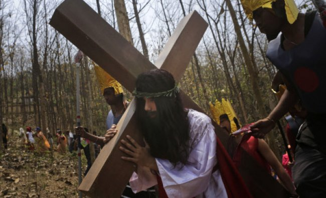 Indian Christian devotees enact the crucifixion of Jesus Christ to mark Good Friday...