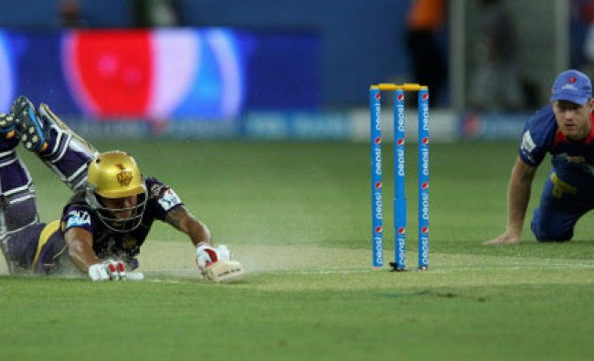 Manish Pandey of the Kolkata Knight Riders dives for home during match 6 of the Pepsi...