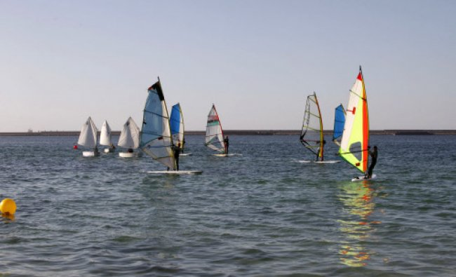 Libyans take part in a local windsurfing competition in Tripoli April 19, 2014. REUTERS