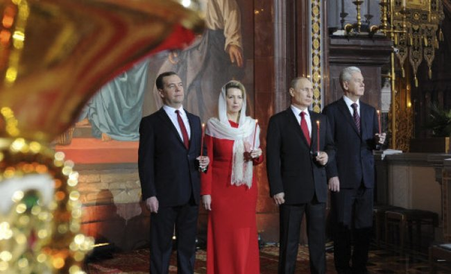 Russian President Vladimir Putin, Moscow Mayor Sergei Sobyanin (R), Prime Minister Dmitry ...