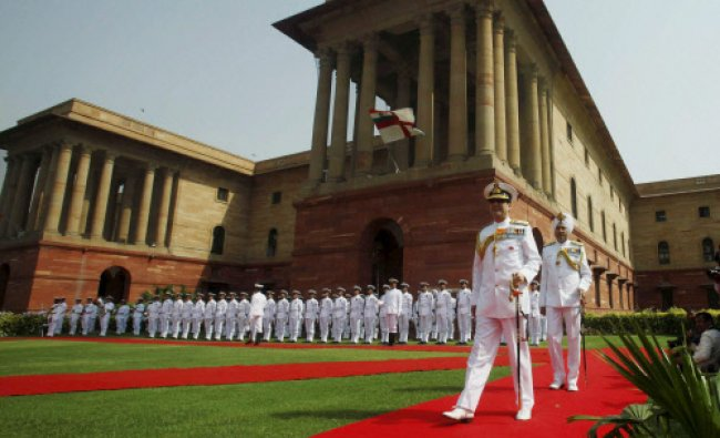 New Naval Chief Admiral Robin K Dhowan after inspects a Guard of Honour at Defence Headquarters...