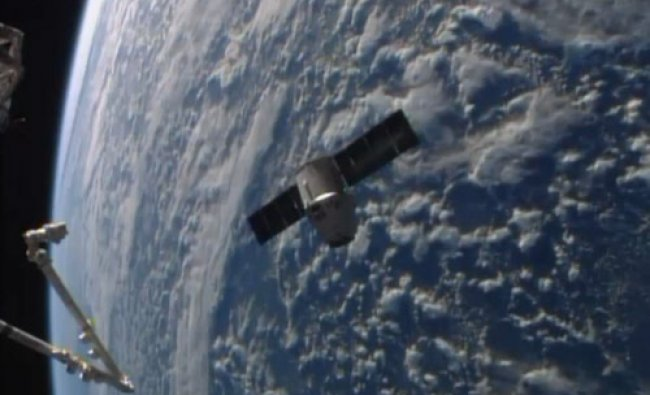 This frame grabbed image from NASA-TV Sunday April 20, 2014 shows the SpaceX Dragon resupply...