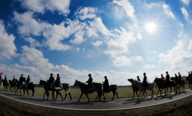 Men of the traditional Sorbian community ride on decorated horses during the traditional Easter...