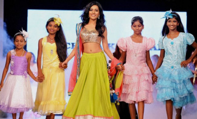 Amrita Rao walks the ramp for Ramp for Champs organised by Smile foundation to raise fund for ...